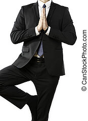 Businessman performs a yoga exercise