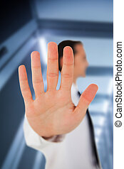 Businessman placing his hand on clear surface