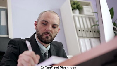Businessman Planning his Schedule - Man fills in the daily...