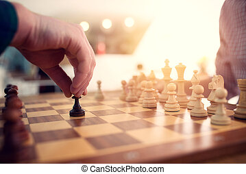 Businessman play with chess game. concept of business strategy and tactic.