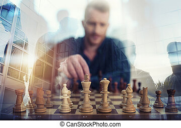 Businessman play with chess game. concept of business strategy and tactic. Double exposure