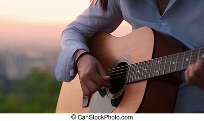 Businessman playing the guitar slow motion