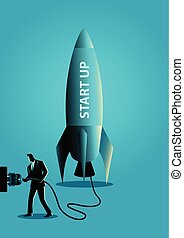 Businessman plugging in a start up rocket