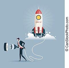 businessman plugging in a start up rocket. Start-up concept