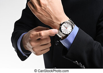 watch - businessman pointing angrily to his watch