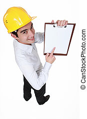businessman pointing at a notepad