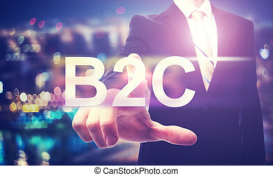 Businessman pointing at B2C on blurred city background