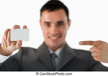 Businessman pointing at business card