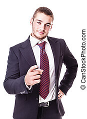 businessman pointing at camera - a young businessman...