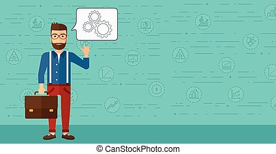 Businessman pointing at cogwheels.