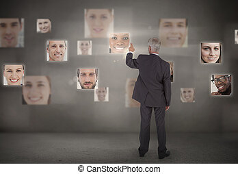 Businessman pointing at digital in