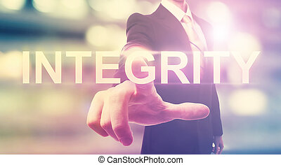 Businessman pointing at INTEGRITY