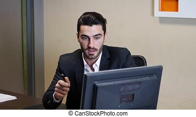 Businessman pointing at monitor screen