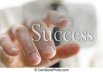 Businessman pointing at success icon on a virtual screen