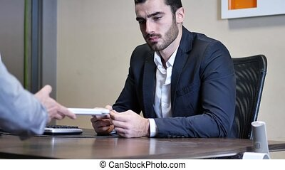 Businessman pointing at tablet PC - Handsome businessman...