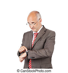 Businessman Pointing At Wristwatch While Looking Away