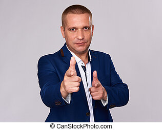 businessman pointing at you. Isolated