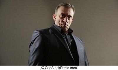 Businessman Pointing Hand Gun. gangster threatens gun. a...