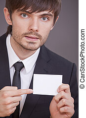 businessman pointing on blank visit card