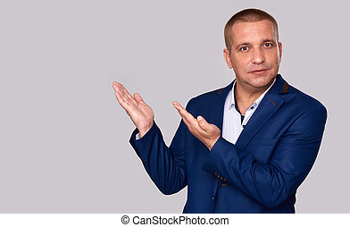 Businessman pointing to copy space
