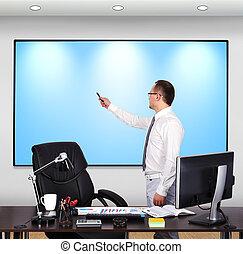businessman pointing to plasma panel
