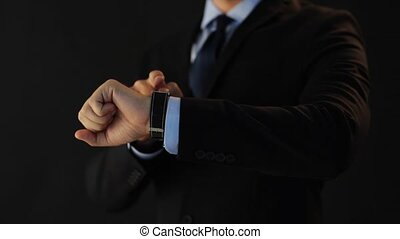 businessman pointing to smart watch on his hand