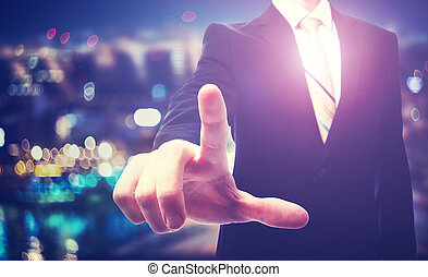 Businessman pointing to something on a blurred background