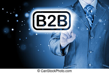 businessman pointing to word B2B, business-to-busines s, ...
