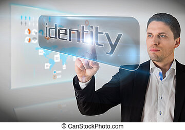 Businessman pointing to word identity against technology...