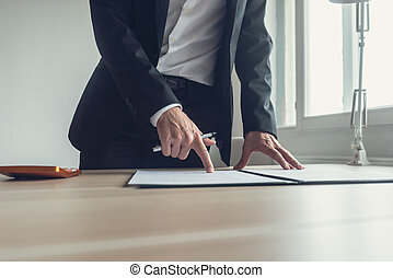 Businessman pointing where to sign a contract