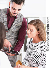 Businessman points a finger at the tablet