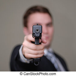 Businessman Points Gun with Shallow Depth of Field - Young ...