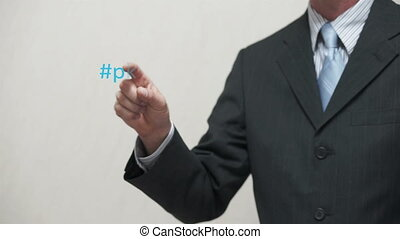 Businessman Pokes Business Words Ha - Shot of an anonymous...