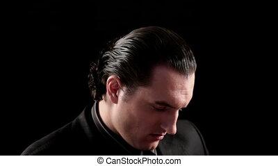 businessman portrait on black