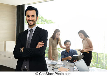 Businessman posing confident and positive in professional workplace office