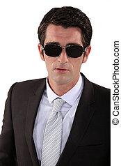 Businessman posing in sunglasses