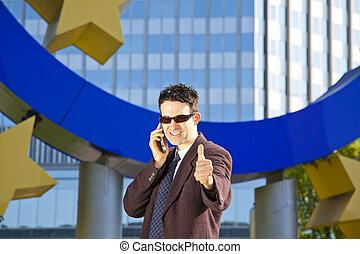 businessman posing thumbs up
