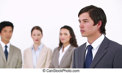Businessman posing with his team