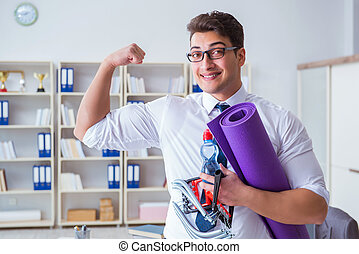 Businessman preparing to go exercising in gym