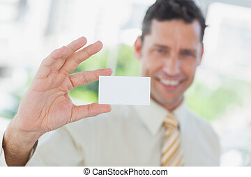 Businessman presenting blank business card