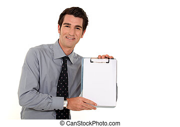 Businessman presenting clip-board
