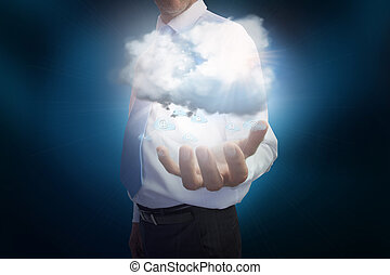Businessman presenting cloud - Digital composite of ...