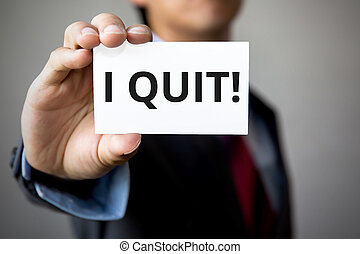 Businessman presenting 'I Quit' word on white card