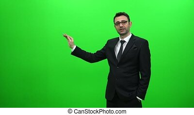 Businessman Presenting in Front of a Green Screen. Right Side.