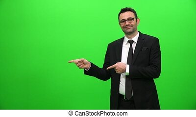 Businessman Presenting in Front of a Green Screen