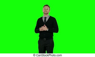 Businessman presenting something in the studio. Green