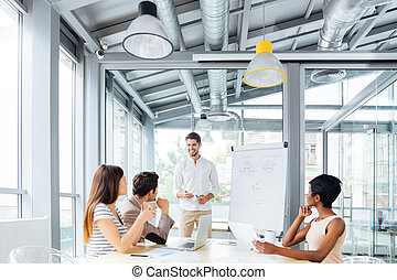 Businessman presenting something on flipchart