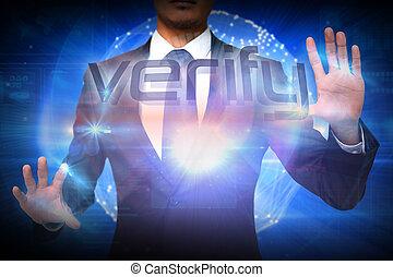 Businessman presenting the word verify against futuristic...
