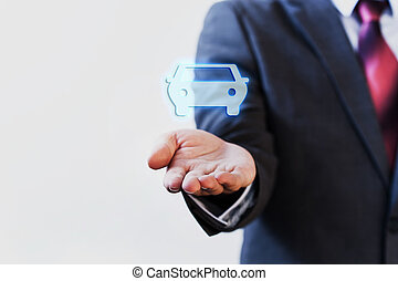 Businessman presenting virtual car on his palm of hand