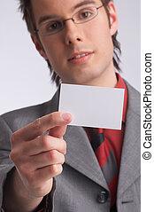 card - businessman presents a business-card